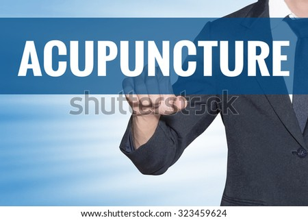 Business man touching Acupuncture word on blue virtual screen - stock photo