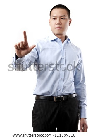 Business man touching an imaginary screen or button on white background - stock photo