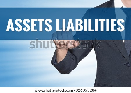 Business man touching Assets Liabilities word on blue virtual screen - stock photo