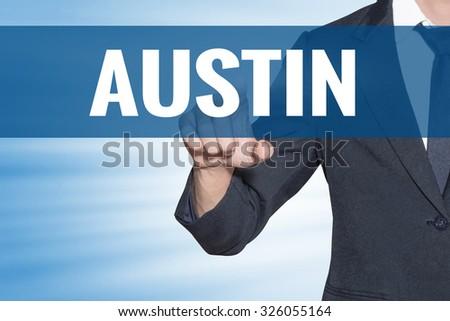 Business man touching Austin word on blue virtual screen - stock photo