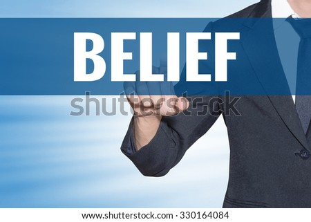 Business man touching Belief word on blue virtual screen - stock photo