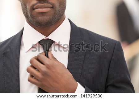 business man touching his tie. Close up - stock photo