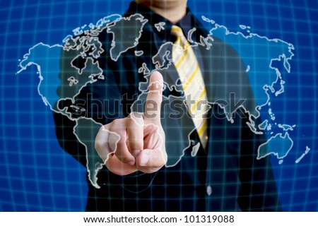 Business man touching on world map on virtual screen - stock photo