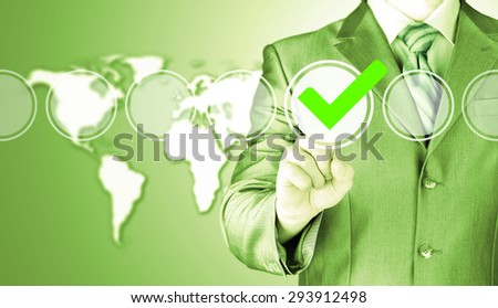 business man touching, pressing modern button with green ticking Check Box. - stock photo