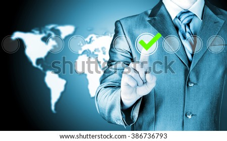 business man touching, pressing modern button with green ticking Check Box.