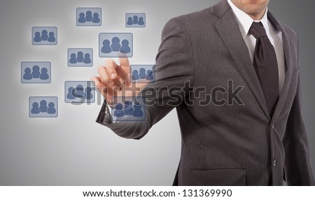 business man touching social network structure icon, grey background