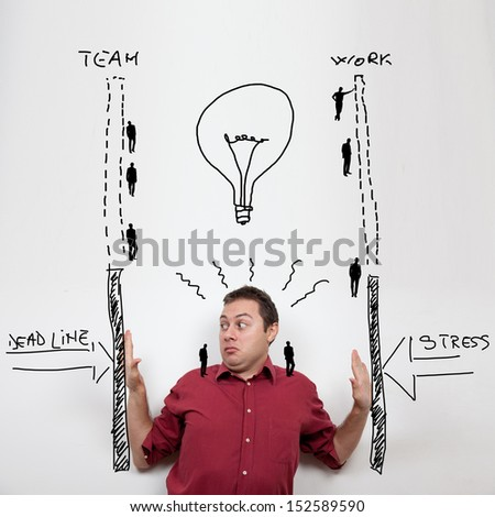 Business man under pressure of stress and deadlines being helped by his team - stock photo