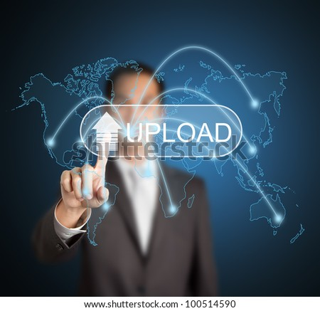 business man uploading digital file and information data to different destination in the world via computer network by pressing touchscreen button - stock photo