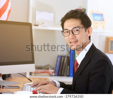 Business man use computer in office .business man working on computer.