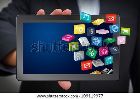Business man use tablet pc with cloud of colorful application