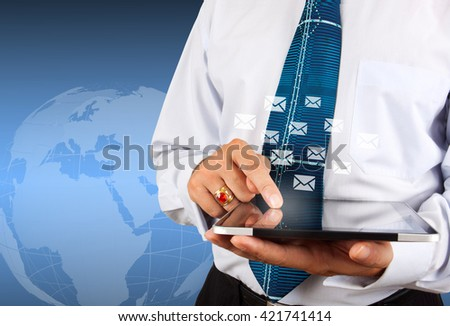 Business man use tablet pc with social media icons - stock photo