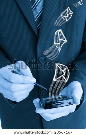 Business man using a pda - stock photo