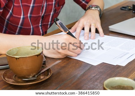Business man using a pen to signing a contract  - stock photo