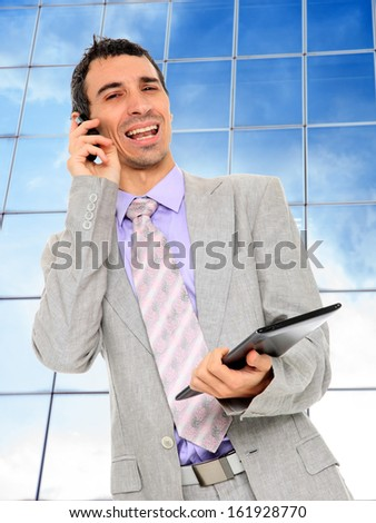 Business man using a table PC