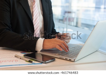 Business man using a telephone to shopping Online Credit card in the office.