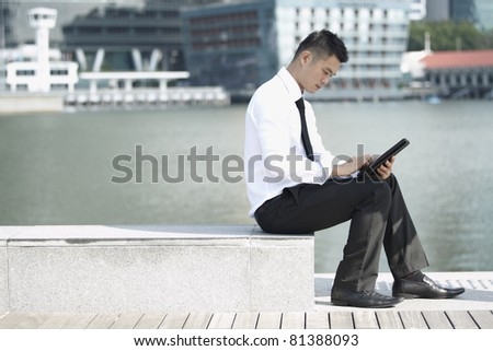 Business man using a touch pad - stock photo