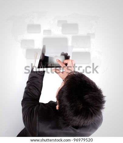 Business man using a touch screen device - stock photo