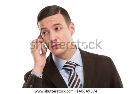 Business man using cellphone. Isolated on a white background. - stock photo