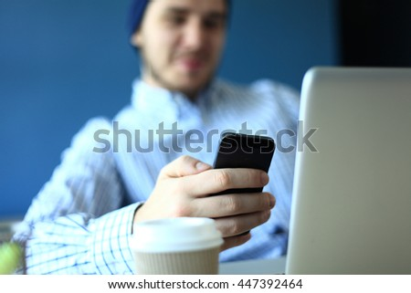 business man using internet on smart phone and laptop - stock photo