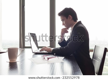 Business man using laptop computer - stock photo