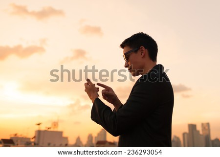 Business man using mobile smart phone - stock photo