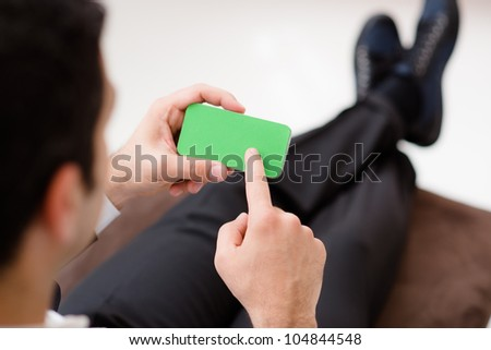 Business man using smart phone with green screen for internet and email. Sequence - stock photo