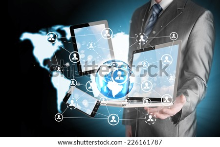 Business man using tablet PC and smartphone social connection