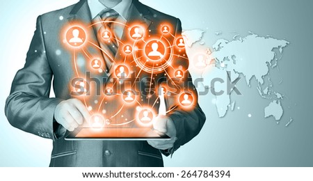 Business man using tablet PC. conceptual image of social connection