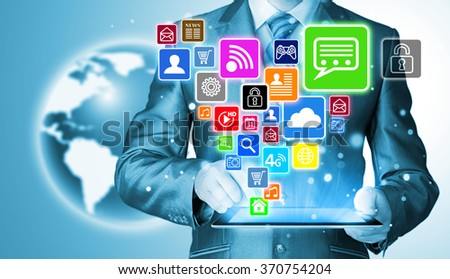 Business man using tablet PC with social media icon set - stock photo
