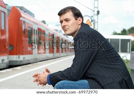 Business man waiting for a train