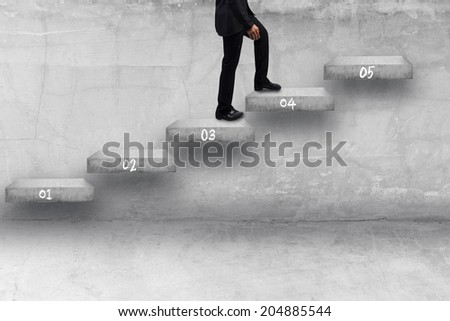 business man walking step by step of business to success and growth - stock photo