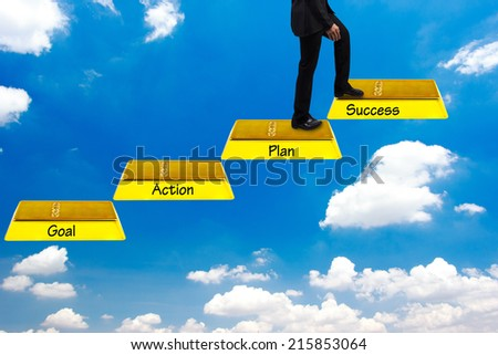 business man walking up gold bars stepping ladder on blue sky and word goal plan work  success idea concept step by step for success and growth business - stock photo
