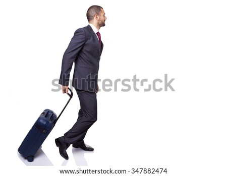 Business man walking with suitcase on white background - stock photo