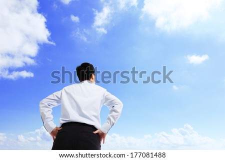 Business man watching the sky with copy space - stock photo
