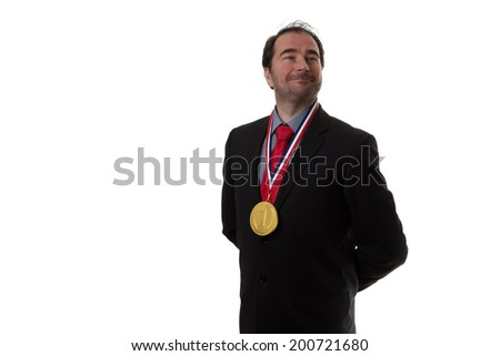 Business man wearing a chocolate gold medal around his neck