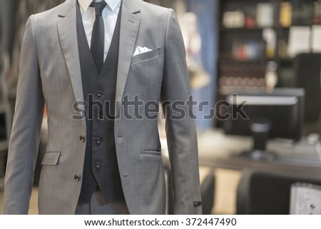 Business man wearing suit no head standing in his office - stock photo