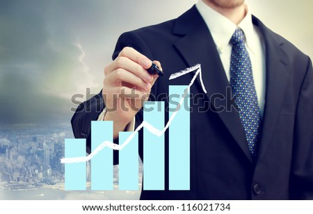 Business man with a chart showing growth with city background - stock photo