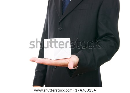 Business man with a cube in hand isolated on a white background