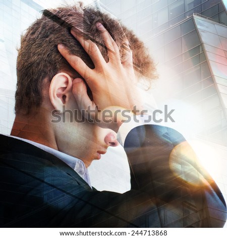 Business man with a depressed expression - stock photo