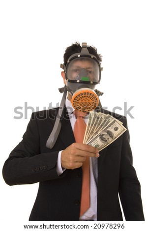 business man with a gas mask holding banknotes
