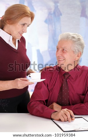 business man with a lady drinking coffee on a background