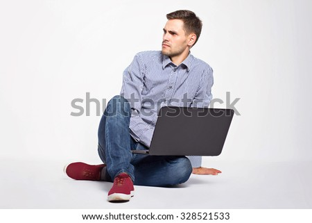Business man with a laptop on a white background