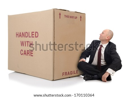 business man with a large cardboard box over a white background - stock photo