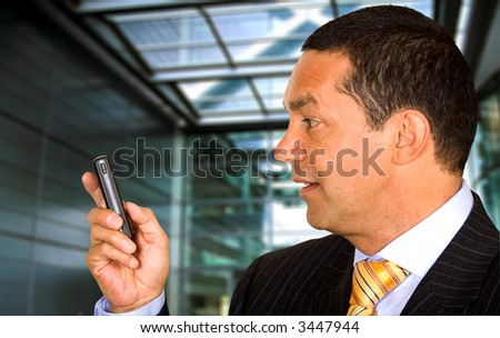 Business man with a mobile phone in a corporate environment