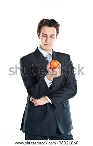 Business man with a red apple