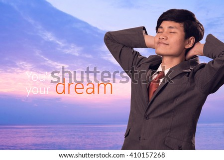 business man with arms crossed behind head with sea background, relax concept - stock photo