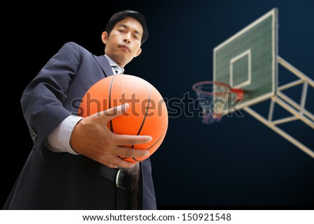 Business man with basketball - stock photo
