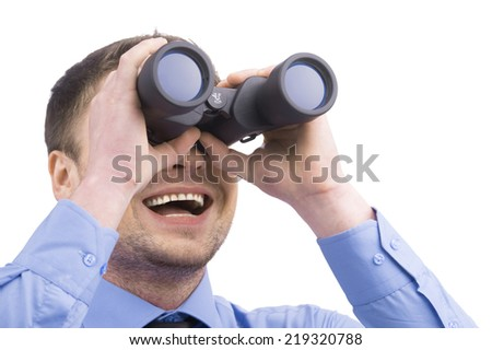 Business man with binoculars on white background. man wearing blue shirt holding binoculars - stock photo