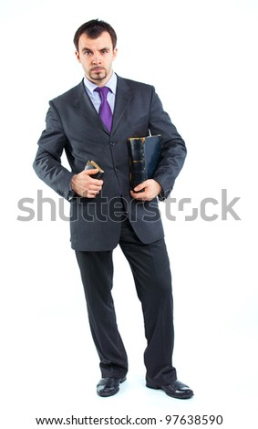 Business man with book isolated on white background. Studio shot.