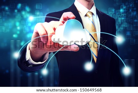Business man with cloud computing concept on blue technology background - stock photo